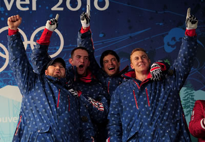 Curt Tomasevicz celebrates with the 2014 Olympics bobsledding team from the U.S.