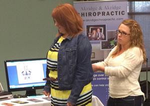 Jenn demonstrates a spinal screening  for Akridge Chiropractic.
