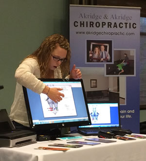 Jenn explains the spinal screening results for Akridge Chiropractic.